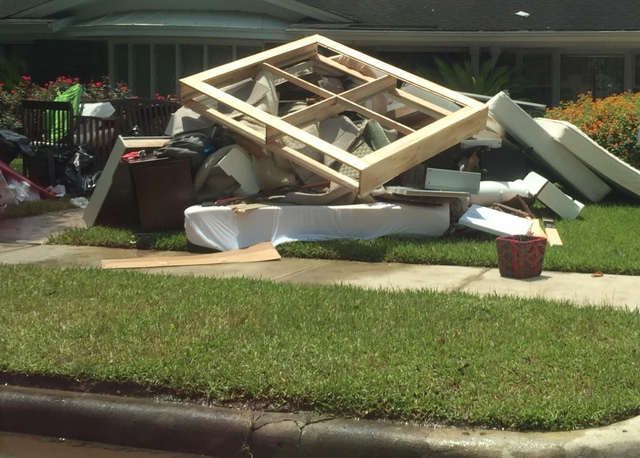 Every house has furniture and belongings out front